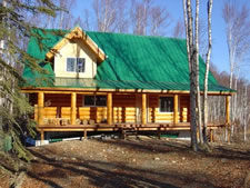 We do the interior of log homes and cabins. Once the logs are set we take over.